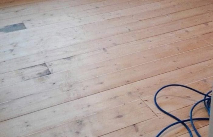sanding and repairing gaps in wood flooring Stepaside