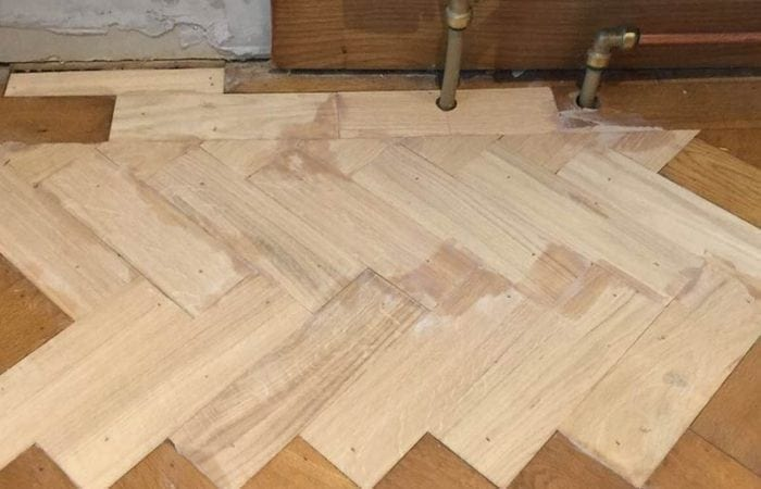 Repairing old parquet flooring with new wood Palmerstown